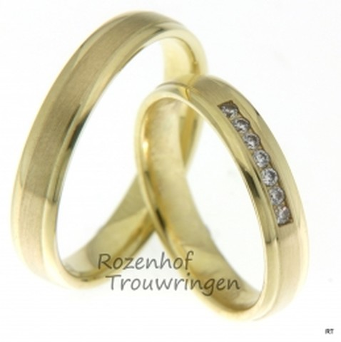 Deze 4 mm brede geelgouden trouwringen met matte binnenbaan geven deze klassiek ogende ringen een eigentijdse uitstraling. De dames trouwring is bezet met 7 schitterende, briljant geslepen diamanten van in totaal 0,105 ct.