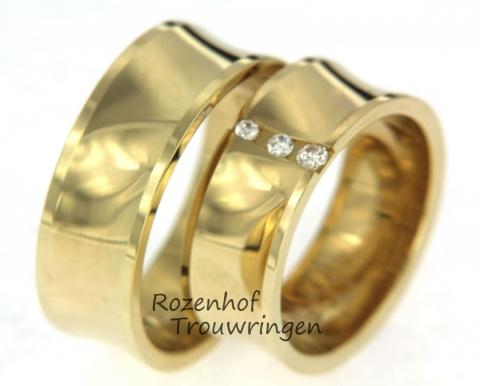 Glanzende geelgouden trouwringen met diamant