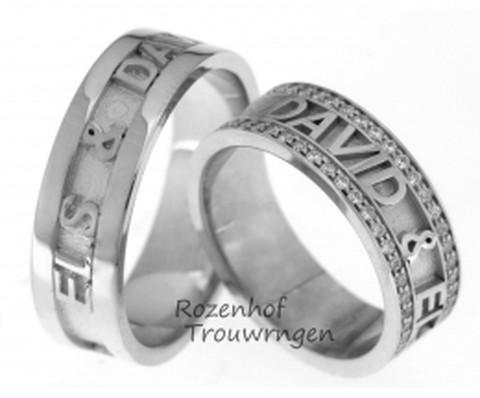 Persoonlijke naamringen in witgoud. In de dames trouwring zijn jullie namen gevat in twee rijen met in totaal 88 briljant geslepen diamanten.