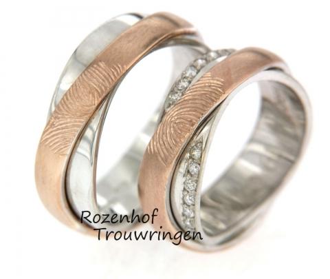 Exclusieve trouwringen uitgevoerd in wit- en roodgoud. De ring bestaat uit twee lagen die over elkaar heen lopen. De ringen zijn 6 mm breed. De damesring is bezet met twee velden vol schitterende diamanten met per veld 7 briljant geslepen diamanten van 0,07 ct. Ook is het mogelijk op 4 velden met diamanten te bezetten of 1 veld. De ringen zijn gepersonaliseerd door middel van een vingerafdruk van u geliefde. Deze ringen zijn ook leverbaar in wit- en geelgoud. de ringen zijn verkrijgbaar in 9, 14 en 18 karaat goud.