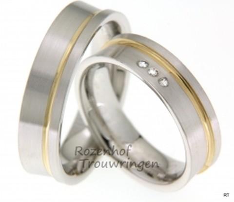 Bicolor trouwringen van 6 mm breed. De ringen zijn van mat witgoud gemaakt met een geelgouden ader. In de dames trouwring zijn 3 briljant geslepen diamanten gezet van in totaal 0,045 ct.