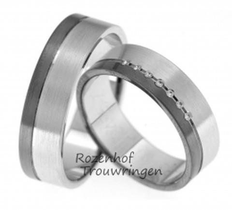 Contrastrijke trouwringen van witgoud met ruthenium. Het visuele contrast tussen het witgouden gedeelte en het donkere ruthenium gedeelte zorgt voor een fashionable ring. Extra chique wordt de dames trouwring door de plaatsing van 7 briljant geslepen diamanten van 0,046 ct. De ringen zijn 6 mm. breed.