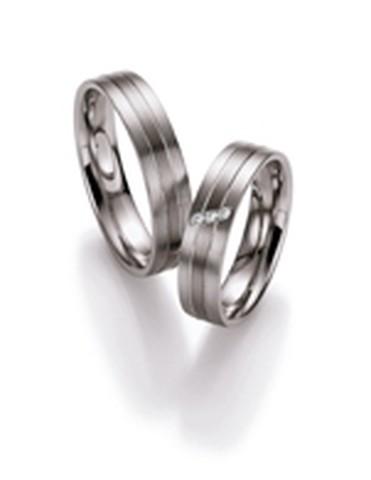 Trouwringen van palladium met witgoud van 5 mm breedte met 3 briljant geslepen diamanten van 0,03 ct