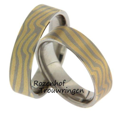 Trouwringen met een kronkel!De prachtige kronkelende geelgouden en witgouden aderen maken van deze trouwringen een uniek geheel. Bij deze ringen is garne megane techniek gebruikt.