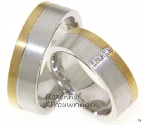 Classy, bicolor trouwringen met een moderne look. Fraai uitgevoerd in mat witgoud en mat geelgoud. De ringen zijn 7 mm breed. Classy staan de 3 briljant geslepen diamanten van in totaal 0,045 ct, welke in de dames trouwring gezet zijn.