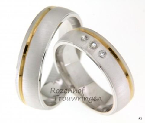 Ringen met een lintje. Bicolor trouwringen, welke een breedte hebben van 6 mm Bolle witgouden ringen met mooie matte finish. Een glanzend geelgouden lint loopt over de ring. In de dames trouwring zijn 3 briljant geslepen diamanten vanin totaal 0,06 ct gezet.