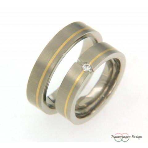 Moderne titanium relatieringen met goud