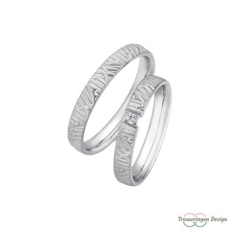 Zilveren trouwringen met zwevende diamant